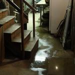 Water flooding across basement floor.